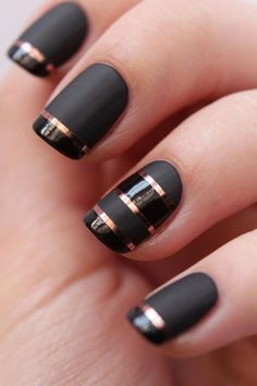Stripped nail art designs in black and gold