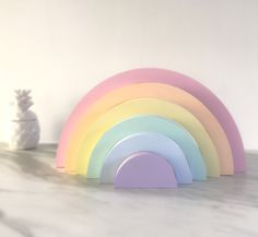 Hand Painted Stacked Wooden Rainbow, Our wooden rainbow comes in a choice of lovely colours to match any room of the home.