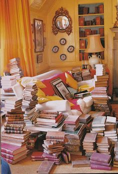 if I'm not careful this is what my chair will look like in the future, I'm always surrounded by a stack of books.