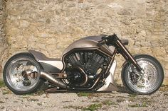 Germany's Custom-Wolf guys are no strangers to famous bikes, but this time it's close to outdoing themselves: witness their all-new V-Rod X, by far one of the meanest H-D roadsters we saw this year.