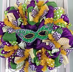 Deco mesh Mardi Gras Wreath with hand painted wooden masquerade mask on Etsy, $85.00