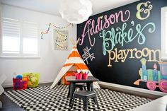 colorful play space with a chalkboard wall, a teepee and a desk