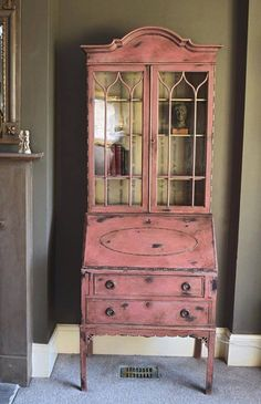 Scandinavian Pink Chalk Paint® finish with Old Ochre on the interior. Jonathon Marc Mendes of Painted Love used a wet distressing technique on the piece as well as Dark Chalk Paint® Wax and Gilding. There's beautiful design details with the Annie Sloan Branches Stencil, and the additional use of Olive, Chateau Grey, and Primer Red Chalk Paint® colors.