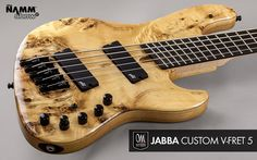 "Mayones Jabba Custom V-Frets 5 Eye Poplar top, Swamp Ash body back, Transparent Natural Gloss body finish, 1-ply Hard Rock Maple neck, bolt-on construction, Ebony fretboard, Scale: V-Frets 33"" - 35"", 24 jumbo frets, only side dot markers, Radius 20"", Aguilar Amplification DCB G5 humbucker pickups, Darkglass Electronics Tone Capsule 3-band preamp with Passive Tone, 1 × mini switch Active/Passive mode"