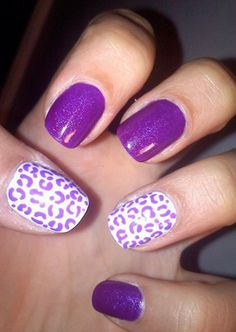 you see some nice pruple nail design for short nails, which uses a combination of plain purple nails and white nails with some very nice purple decorations.