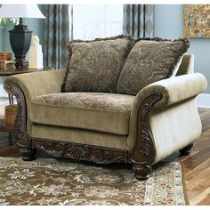 "With a classic traditional style and a supportive comfortable design, the ""Millington-Meadow"" upholstery collection features elegantly shaped rolled arms and richly detailed carved showood accents in a rich finish all perfectly combined with a comfortable yet classically designed upholstery fabric."