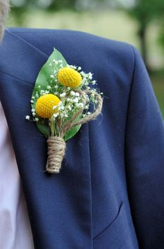 men's boutonnieres- billy buttons and baby's breath, wrapped in twine