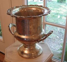 Looking for a tarnished silver champagne bucket...