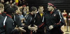 HWT Spencer Myers slapping hands with the team during warm ups at home in the Comcast Center Wrestling Facility.  Maryland Athletics - University of Maryland Official Athletic Site