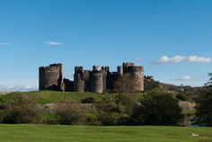 Caerphilly Castle - The largest castle in Wales, the castle was built in the century by Gilbert de Clare, a nobleman of Norman descent who also built the original Castell Coch. Welsh Castles, Castles In Wales, Wales Uk, England And Scotland, Wilderness Survival, Outdoor Survival, Monument Valley, New York Skyline, Beautiful Places