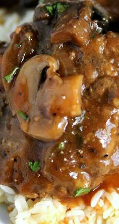 Slow Cooker Salisbury Steak Recipe ~ Tender beef patties simmer all day in a rich gravy with mushrooms and onions for a truly comforting meal.