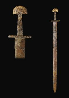 A double-edged Viking sword, marred with patina. Forged out of iron. Made in the 10th/11th century for a Viking warrior in Northern Europe. Found in a river in South Germany. Sold at a Christies auction for $29,264.