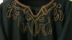 Front of mens tunic I made for my husband. Embroidery freehand horses.