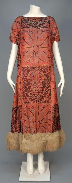 1920s JACQUARD dress with metallic threads and fur hem trim.