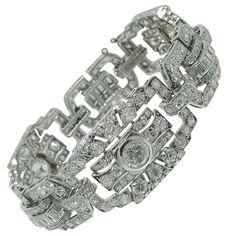 Classic Art Deco Pave Diamond Gold Bracelet. An Art Deco gold diamond bracelet, approx. 12cts of round and baguette cut diamonds.