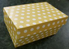 Covering a shoe box with wrapping paper