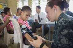 U.S. Navy Hospital Corpsman 3rd Class Tara Macdonald checks the vital signs of a child being screened during a Pacific Partnership health fair to compete in Samoan Special Olympics activities. Pacific Partnership is the largest disaster response-preparation mission in the Indo-Asia-Pacific region. The mission contributes to stability and security by opening dialogue and fostering friendships between leaders so that they are better prepared to work together when a regional disaster strikes…