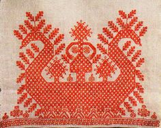 .:. 	  Novgorod region - 1860s  This is The Sun Shallop.   It is pulled by a pair of swans (their heads are shown as ends of a shallop).   The Sun Maiden drives a vehicle.   A checkered pattern covering the whole image means that characters depicted are gods; and they have a strong connection with The Sun and The Water - productive powers of the world.   The Shallop sprouts with tree branches.    .:.