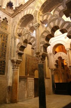 """Polylobed arches of the maqsura (maksoureh) screens (and part of the mihrab entrance on the left) from the Great Mosque of Cordoba, Spain, c. 965. Source.  """"The maqsura… [is] the area directly in front of the prayer niche [mihrab] reserved for the caliph and his royal entourage. The maqsura includes three domed bays covered, like the dome of the mihrab, with precious mosaics of gold and lapis lazuli, and decorated with abstract geometric patterns, vegetal forms, and sacred inscription"""