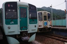 JR Shikoku 1500 series and Asa Seaside Railway ASA-300 type train in Kaifu station, Tokushima