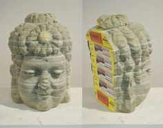 Long-Bin ChenSmall Buddha with Flower(Manhattan), 2009NYC phone book111/2 x 8 x 7 inches  Taiwanese artist Long Bin-Chen uses discarded old books to create incredibly detailed sculptures that look like they're made of  marble or wood. Although all his artworks are made out of several  books, he carves them all in such a manner that they fit together in a  seamless manner. While he could use any books he gets his hands on, Long  Bin-Chen only uses those that are relevant to his sculptures. F