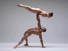 This is an utterly amazing display of strength, agility, balance, and above all, beauty by these members of the Alvin Ailey American Dance Theater Company. Image via Afrikan Knowledge: Beyond The Book Club.