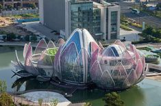 In Australian architecture firm completed the Lotus Building, a community center set atop an artificial lake in Wujin, China. The city government commissioned the sculptural building. Australian Architecture, Futuristic Architecture, Beautiful Architecture, Landscape Architecture, Landscape Design, Architecture Design, Unusual Buildings, Amazing Buildings, Museu Guggenheim Bilbao