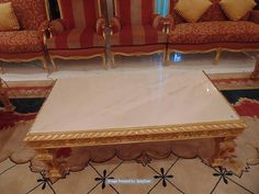 Lot 715 - Neoclassical Italian painted and parcel gilt coffee table with marble top, rope edge frame with a