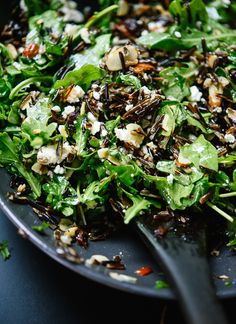 This wild rice salad includes arugula, dried cherries, toasted almonds and feta, tossed in a zippy lemon dressing! It's gluten free, filling and delicious.