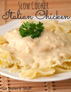 Slow Cooker Italian Chicken from sixsistersstuff.com.  This creamy sauce makes this chicken over the top! #recipes #slowcooker #Italian #chicken