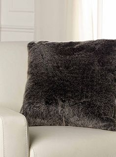 Exclusively from Simons Maison     Rich fleece that warms any room with thick and smooth faux fur in a natural grey tone.    Washable with removable cover and a hidden zip on the edging   Matching throw also available   55 x 55cm