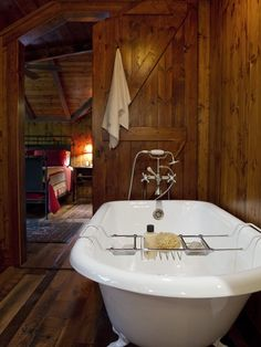 cabin bathroom - you gotta love a ball and claw bathtub with that great handheld shower feature.