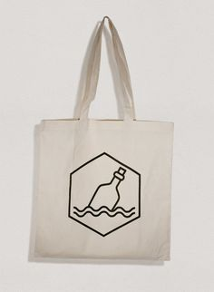Tote Bag with 'Bottle' communiqué logo.