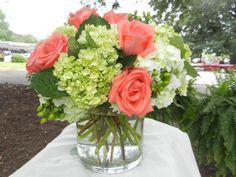 White and Green Hydrangea, Coral Roses and Green Hypericum Berries.  Spring 2012.