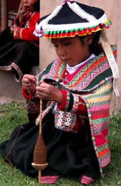 Children in the highlands of #Peru learn to #handspin by watching their Elders.  ClothRoads