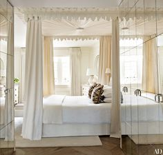 Solomon & Wu plaster cornicing crowns the canopy bed in the master suite | archdigest.com