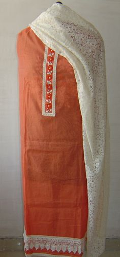 Front profile of chanderi suit with pearl accents and lace dupatta. For orders and inquiries, please mail us at naari@aninditacreations.com.  Like us at www.facebook.com/naari.aninditacreations