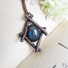 Boho labradorite necklace Witch jewelry Woodland pendant Rustic... ($35) ❤️ liked on Polyvore featuring jewelry, crystal pendant jewelry, bohemian jewellery, pendant jewelry, bohemian style jewelry and boho chic jewelry