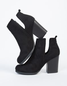 Let these Side Slit Suede Chunky Booties make their way into your heart or closet, or both. These booties come in two colors and features a round almond toe, chunky wooden heel, and two side slit openings for an easy wear. We love these shoes paired with a flowy off-the-shoulder dress, dainty pendant necklace, and a crossbody leather purse.