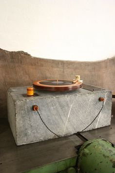 Handmade record player made out of a solid block of marble and a wooden platter & tonearm. Weighs over 500 pounds, by Tyler Hays