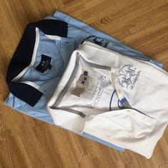 His and Hers matching Polo shirts Men's size large (blue), women's size small (white). Maserati logo polo shirts by La Martina. Trying to make the sale today!! Great condition! Tops