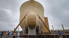 Visitors roam around a replica Noah's Ark as rain clouds pass overhead at the Ark Encounter theme park during a media preview day, Tuesday, July 5, 2016, in Williamstown, Ky.