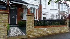 Yorkstone entrance stone victorian mosaic tile path yellow brick garden wall with metal rail slate paving planting London