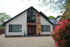 Set back from the road on a generous plot screened by mature trees and hedgerow, this modest chalet bungalow has been transformed into a modern f… – light Single Storey Extension, Roof Extension, Bungalow Extension Plans, Bungalow Floor Plans, Bungalow Extensions, House Extensions, Bungalow Conversion, Dormer Bungalow, House Cladding