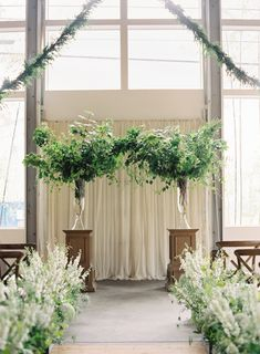 A Seattle wedding designed around the vision of an urban garden. Instead of traditional flowers, the bride and groom chose to have natural greenery take the place in centerpieces and ceremony decor.