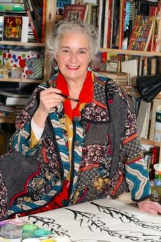 Textile designer Sarah Campbell (Collier Campbell) wearing an amazing jacket in her studio