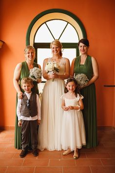 Bridesmaids in olive green dresses. Photography by www.arj-photo.co.uk