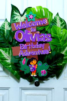 Awesome welcome wreath at a Dora the Explorer girl Birthday Party! See more party ideas at CatchMyParty.com!