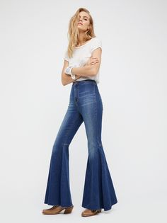 Just Float On Flare | In a clean silhouette with a flat front these high-rise jeans feature a flared leg with a raw hem.      * Back seam detailing on the knee.    * Super soft and super stretch fabric.    * Back pockets.    * Button closure and zip fly.