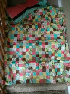Partially finished 9-patch quilt (made from a jelly roll!). Backing, border, and binding fabric included in picture.